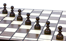 Pawns on a chessboard Stock Photo