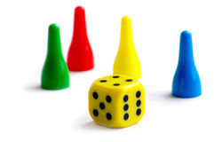 Pawns and dice Stock Image