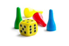 Pawns and dice Royalty Free Stock Photography
