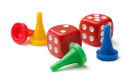 Pawns and dices Stock Images