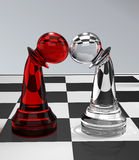 Pawns in love. Chess - two pawns on the chessboard falling in love Stock Images