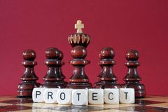 Pawns protecting chess king Royalty Free Stock Photo