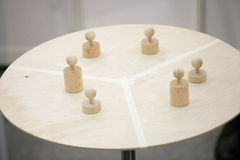 Pawns on round table Stock Image