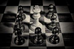 Pawns surrounding king. A social upheaval concept Royalty Free Stock Photos