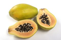 Pawpaw. Macro picture of two ripe pawpaw over white background Royalty Free Stock Photos