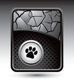Pawprint on cracked silver backdrop Royalty Free Stock Photography