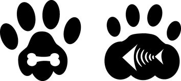 Paws of dog and cat with bones. Black paw of dog and cat decorated with bone and fishbone Royalty Free Stock Photos