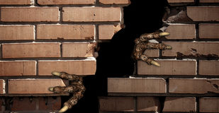 Paws of monster , breaking a brick wall Stock Photos