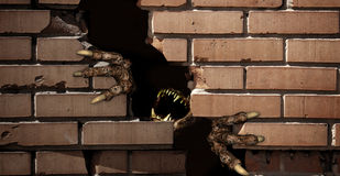 Paws of monster , breaking a brick wall Royalty Free Stock Images