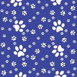 Paws seamless navy blue pattern, paw background, vector illustration stock illustration
