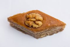 Paxlava or Pakhlava as National cookie with nuts isolated macro image. Paxlava or Pakhlava as National cookie with nuts isolated macro close shot image royalty free stock photography