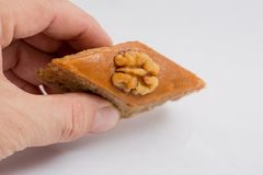 Paxlava or Pakhlava as National cookie with nuts isolated macro image. Paxlava or Pakhlava as National cookie with nuts isolated macro close shot image royalty free stock images