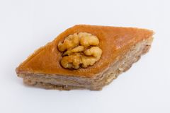 Paxlava or Pakhlava as National cookie with nuts isolated macro image. Paxlava or Pakhlava as National cookie with nuts isolated macro close shot image royalty free stock photos