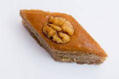 Paxlava or Pakhlava as National cookie with nuts isolated macro image. Paxlava or Pakhlava as National cookie with nuts isolated macro close shot image stock image