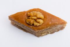 Paxlava or Pakhlava as National cookie with nuts isolated macro image. Paxlava or Pakhlava as National cookie with nuts isolated macro close shot image stock photos