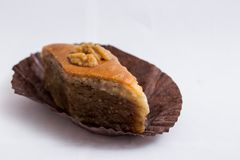 Paxlava or Pakhlava as National cookie with nuts isolated macro image. Paxlava or Pakhlava as National cookie with nuts isolated macro close shot image royalty free stock image