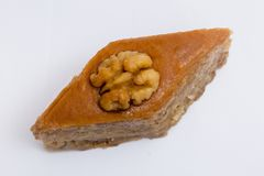 Paxlava or Pakhlava as National cookie with nuts isolated macro image. Paxlava or Pakhlava as National cookie with nuts isolated macro close shot image stock photo