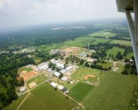 Paxton, FL aerial photo. Paxton is just southwest of the highest point in Florida, Britton Hill, just to the left of the wing in the photo. The elevation is 345 Stock Photos