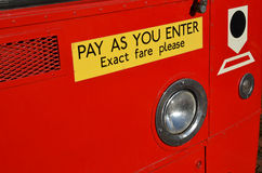 Pay as you enter sign on bus. royalty free stock photo
