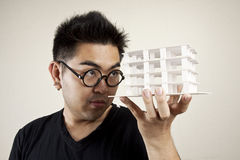 Pay attention. An architect man pay attention at the model Royalty Free Stock Photo