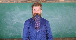 Pay attention to your behaviour and manners. Teacher behaves unprofessionally. Man bearded teacher or educator eats stock image