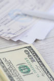 Pay bills with dollars Stock Images