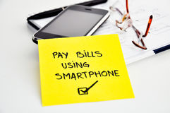 Pay bills using smartphone Stock Photography