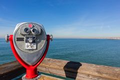 Pay binoculars overlooking the ocean. From the Newport Beach Pier in Orange County California stock images
