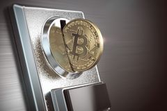 Pay by bitcoin concept. BItcoin coin and coin acceptor. Stock Image