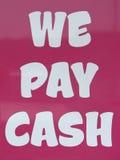 We pay cash. Pink we pay cash sign Stock Photos