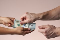 Pay with cash concept. One person give money to other person royalty free stock photo
