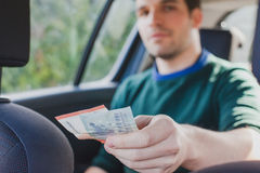 Pay by cash in taxi Stock Photography