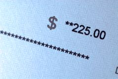 Pay check amount on paper. A check with amount in focus royalty free stock image