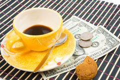 Pay for coffee and cookies. Close-up of pay for coffee and cookies Royalty Free Stock Photos