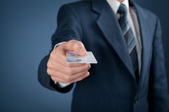 Pay by credit card. Businessman in business suit pay by credit card