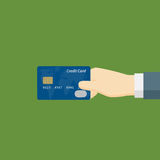 Pay With Credit Card. People Holding Credit Card with Giving gesture Royalty Free Stock Photos