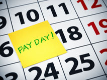 Pay day. Written on a sticky note on a calendar Stock Images