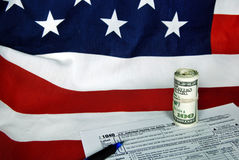 Income tax form on flag Royalty Free Stock Images