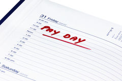 Pay day. Diary opened to pay day on white background Stock Image