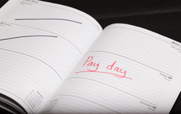 Pay day. Highlighted in a diary Stock Photography