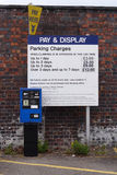 Pay and Display machine. Car park pay & display machine with pricing board royalty free stock photography