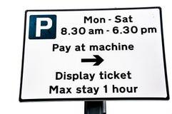 Pay för parkeringsräkneverk & skärmtecken royaltyfri foto