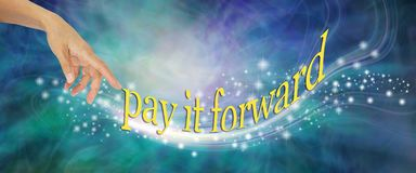 Pay it Forward with loving sparkles. Female hand appearing to send out a whoosh of sparkles with the words PAY IT FORWARDS against a blue green wispy background stock images
