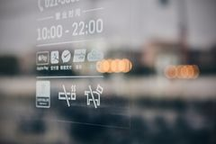 Pay guides are posted in the Windows of restaurants in Shanghai, China royalty free stock images
