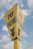 Pay Here!. A sign showing the position of a pay-point isolated with path Royalty Free Stock Images