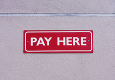 Pay here sign Stock Images