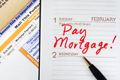 Pay the home mortgage Stock Photos