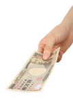 Pay a Japanese 10000YEN bill Royalty Free Stock Image