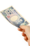 Pay a Japanese 1000YEN bill Royalty Free Stock Photography