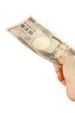 Pay a Japanese 10000YEN bill Stock Photos